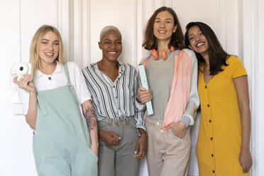Portrait of four smiling women standing side by side - AFVF04492