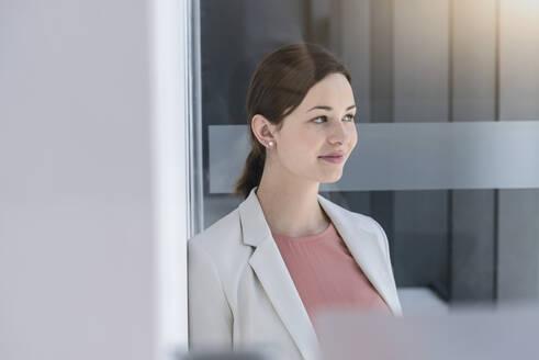 Portrait of young businesswoman having a break in office - BMOF00111