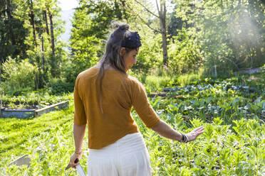 Woman in her garden - TCF06234