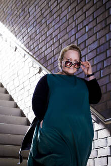 A curvy woman on a staircase - IHF00216