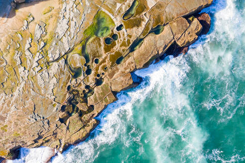 Aerial view above dangerous rock shelf in Sydney's Royal National Park, Australia. - AAEF06099