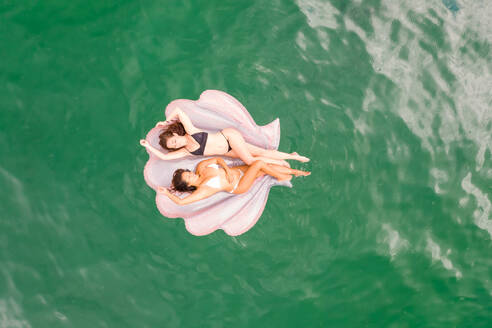 Aerial view of attractive girls with an inflatable at Gordons Bay, Sydney. Australia. - AAEF06117