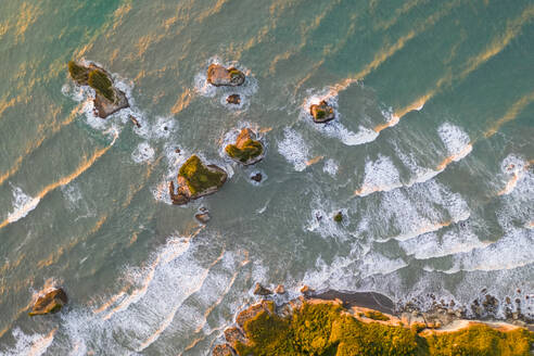 Aerial view of coastal cliff formation at Nine Mile, West Coast during the sunset, New Zealand. - AAEF06165