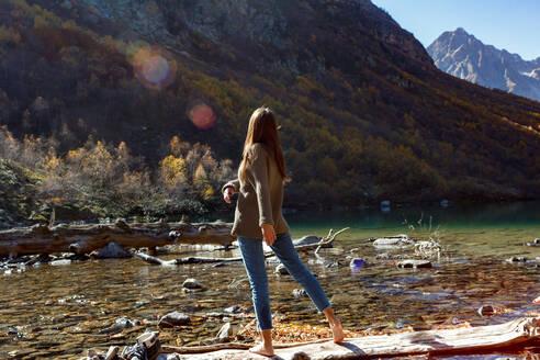 Nice Girl traveler on red autumn lake - CAVF71677