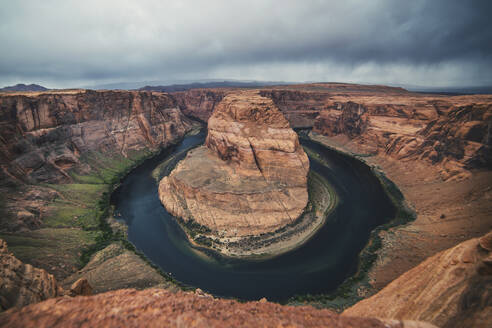 Scenic view of Horseshoe Bend against cloudy sky - CAVF72362