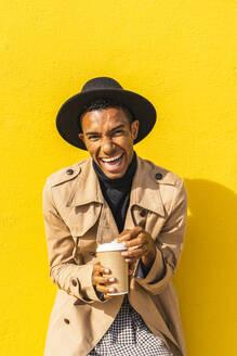 Young man enjoying his take-out coffee - AFVF04567