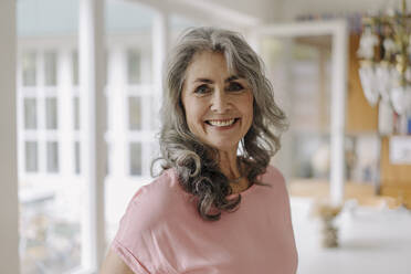 Portrait of smiling mature woman at home - GUSF03039