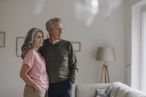 Senior couple standing in living room at home - GUSF03051