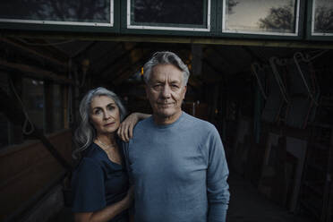 Portrait of a senior couple in a boathouse - GUSF03159
