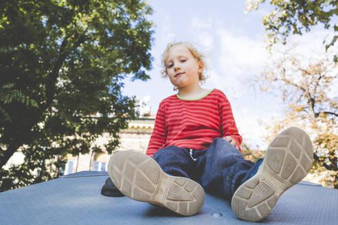 Portrait of blond little boy at playground - IHF00219