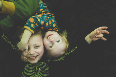 Portrait of siblings playing together in a tent - IHF00240