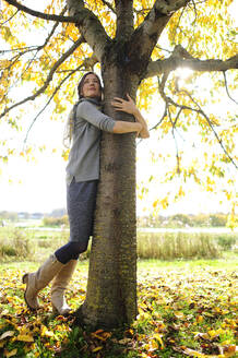 Woman tree hugging - ECPF00796