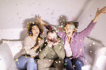 Best friends celebrating party with confetti - FMKF06066