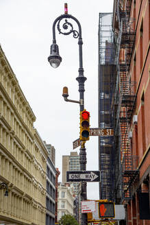 USA, New York, New York City, Stop light and street lamp - CJMF00230