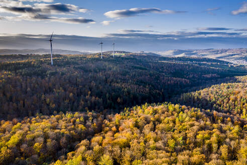 Germany, Baden Wurttemberg, Rems-Murr-Kreis, Aerial view of wind turbines and forest in Autumn - STSF02378