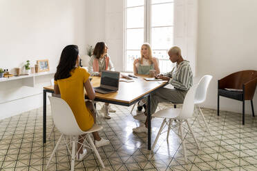 Businesswomen having a meeting in office - AFVF04754