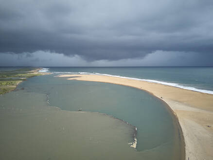 Benin, Grand Popo, Aerial view of storm clouds over sandy beach of Mono River - VEGF01238