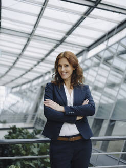 Portait of a confident businesswoman in a modern office building - JOSF04222