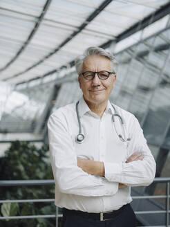 Portrait of a confident senior doctor - JOSF04228