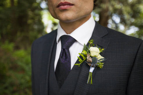 Midsection of bridegroom in full suit - CAVF72529