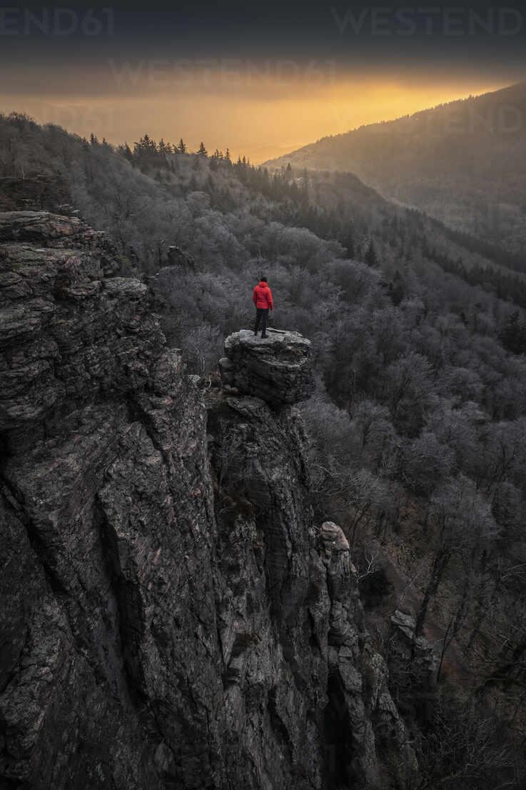 Man standing on rock needle at sunrise at Battert rock, Baden-Baden, Germany - MSUF00116 - Manuel Sulzer/Westend61