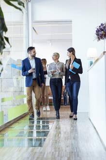 Business people walking and talking in office - JSRF00765