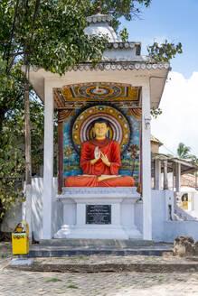 Sri Lanka, Southern Province, Tangalle, Buddha statue at Henakaduwa Purana Viharaya temple - EGBF00531