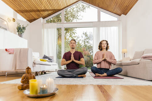 Couple meditating together at home - MFF05023