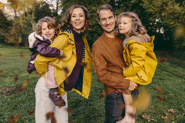 Portrait of happy family with two daughters outdoors in autumn - MFF05041