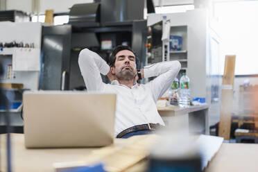 Businessman in a factory having a break - DIGF09109