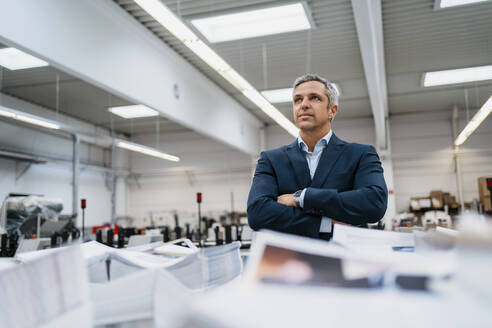 Portrait of a confident businessman in a factory - DIGF09140