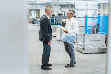 Two businessmen talking in a factory - DIGF09260