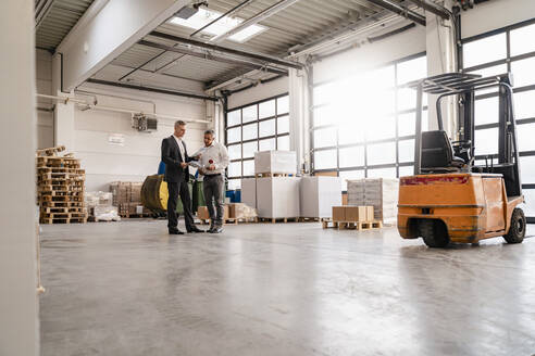 Two businessmen talking in a factory - DIGF09266