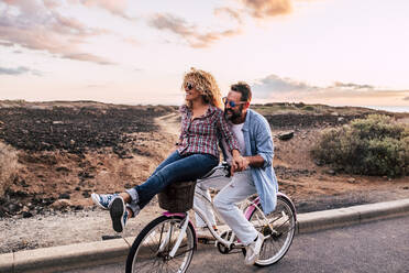 Smiling couple on bicycle, Tenerife, Spain - SIPF02101