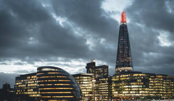 UK, England, London, Clouds over City Hall, Shard and surrounding buildings at dusk - MPPF00436