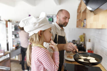 Father and daughter cooking in the kitchen - KMKF01174