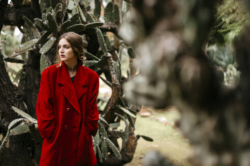 Woman with red coat in a park - TCEF00005