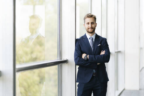Portrait of a confident businessman at the window - DGOF00012