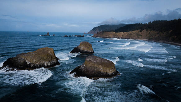 Oregons mysterious and eerie coast holds many rocks - CAVF73549