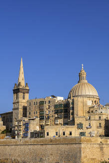 Malta, Valletta, St Paul Pro-Cathedral tower and Church of Our Lady of Mount Carmel dome - ABOF00488
