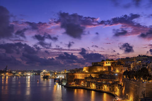 Malta, Valletta, Illumminated city and Grand Harbour at dusk - ABOF00497