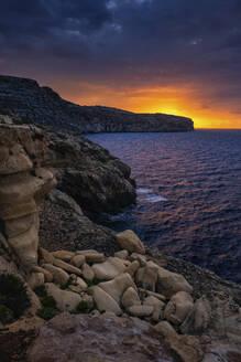 Malta, Rocky shore of Mediterranean Sea at sunrise - ABOF00509