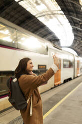 Young woman taking a selfie at the train station - VABF02496