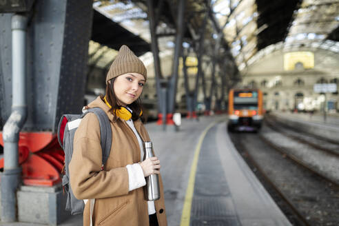 Portrait of smiling young woman at the train station - VABF02505