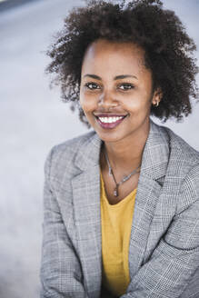 Portrait of smiling young businesswoman outdoors - UUF20206