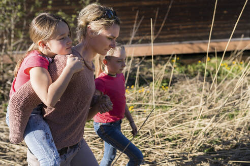 Mother and daughters walking in nature - PSIF00352