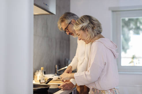 Mature couple in kitchen at home - SODF00510