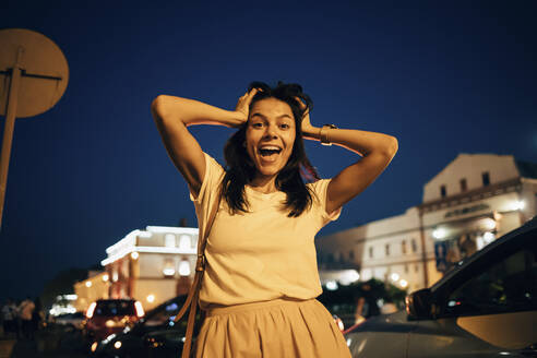Young smiling woman in the city at night - OYF00092