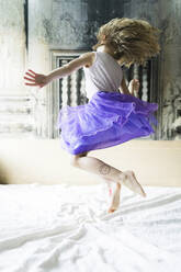 Little girl jumping on bed - PSIF00364