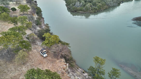 Aerial view of a jeep with a rooftop tent, Cunene river area, Angola - VEGF01458
